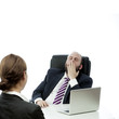 beard business man brunette woman at desk yawn