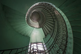 Fototapety Spiral old green and grunge staircase