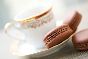 Chocolate macarons and cup of coffee
