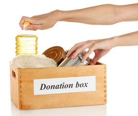 Donation box with food on white background close-up