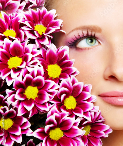 Beauty face of woman with chrysanthemum