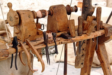 Lathe and tools for woodworking: hammer, chisels, pliers