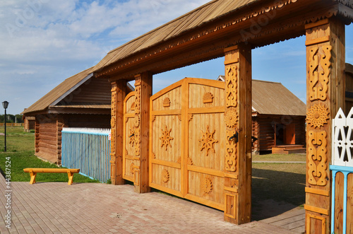 Traditional wooden gate in russian village
