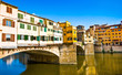 Famous Ponte Vecchio at sunset in Florence, Italy