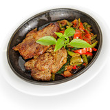 pork steak with vegetables, fried in a pan