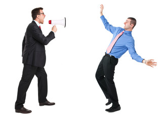 Angry businessman yelling via megaphone to a man