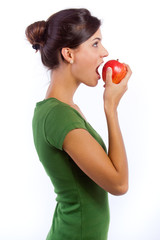 Young woman eating an apple on a white background