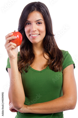 young woman showing an apple on a white background