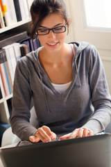 young beautiful woman working at home with a laptop