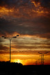 Powerlines and a road lantern at sunset. Vertical shot