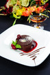 Luscious chocolate dessert with fresh berries on a plate