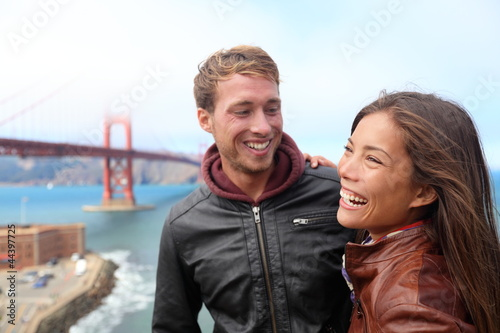 Happy young couple laughing, San Francisco