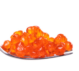 Red caviar over white background