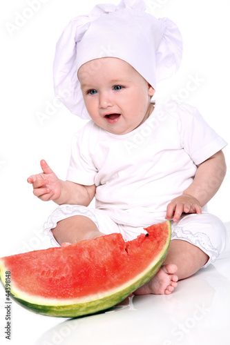 Cute baby chef with watermelon