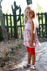 Little girl in garden smiling