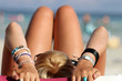 Teenager sunbathing on beach