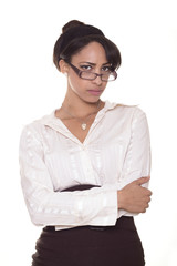 Upset business woman looks over her glasses.