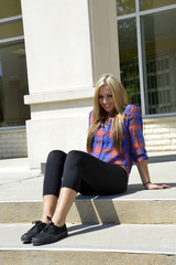 female teenager sitting on concrete steps