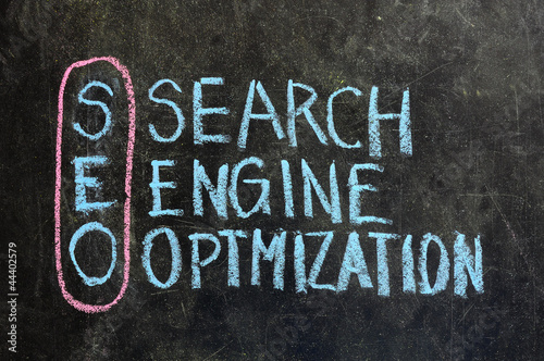 SEARCH ENGINE OPTIMIZATION made with white chalk on a blackboard