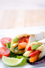 Healthy bite size wraps with side salad and lots of copyspace