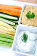 Variety of healthy dips with vegetable sticks