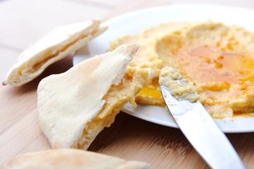 Eating humus, middle eastern cuisine