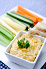 Healthy dip humus and raw vegetable sticks