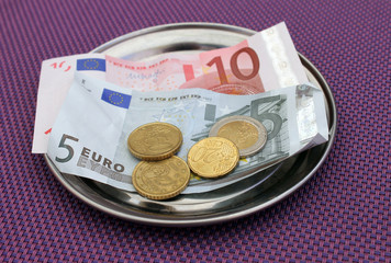 Euro tips on restaurant table