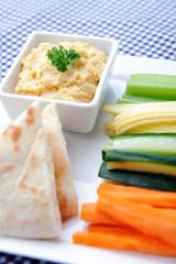 Healthy dip humus and raw vegetable sticks