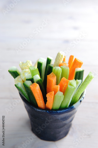 Vegetable sticks in a cup as a healthy snack