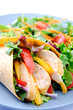 Close up on fresh chicken vegetable wrap with side salad