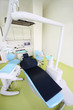 Empty dental clinic. Chair for patient and drill for dentist