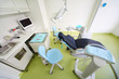 Empty dental clinic. Chair for patient, table with tools