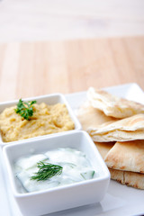 Healthy vegetarian starter platter hummus tzatziki dips