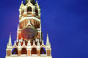 Kremlin chiming clock of Spasskaya Tower at night in Moscow