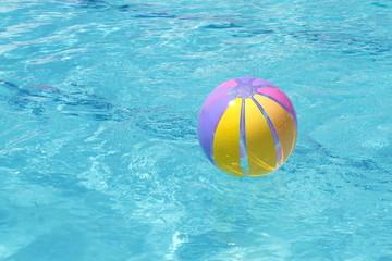 Beachball and swimmingpool. vacation