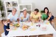 Happy family having breakfast together