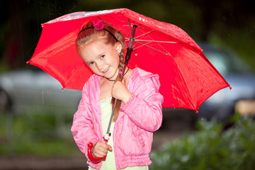 Little girl under an umbrella