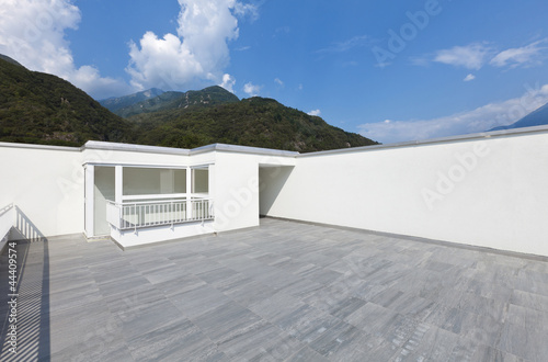 large terrace of a modern white house - 44409574