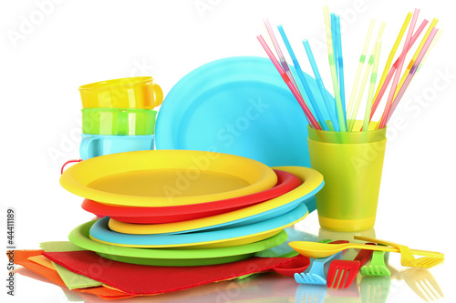 bright plastic disposable tableware isolated on white
