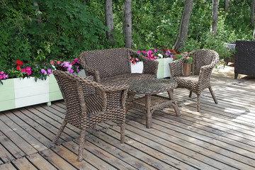 Rattan patio chairs and table  in empty cafe