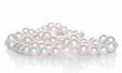 Leinwandbild Motiv String of pearls on white background