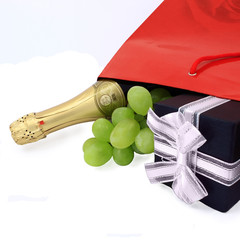 gift, champagne and fruit in the red box