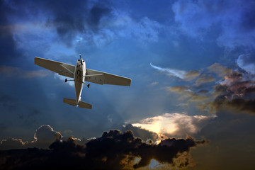 Small fixed wing plane against a stormy sky