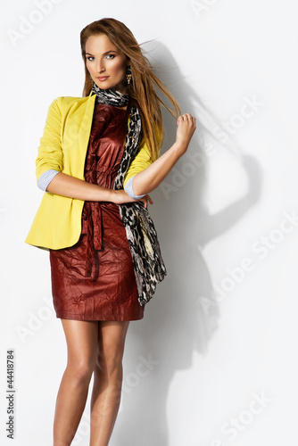 beautiful dark blonde woman wearing yellow jacket and scarf