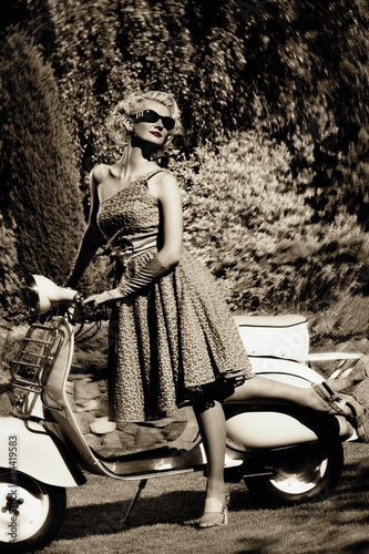 Woman in retro dress with a scooter - 44419583