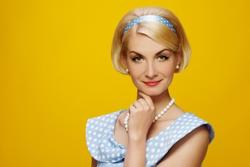 Beautiful smiling woman in blue dress portrait