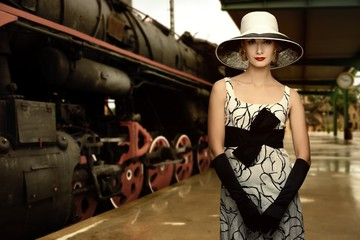Woman in hat on a train station
