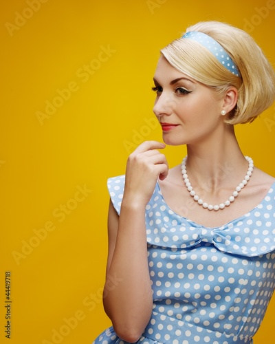 Pensive woman in a blue dress