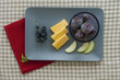 Cheese and fruit plate with red napkin